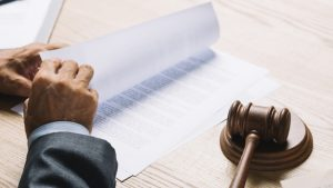 male-lawyer-turning-documents-courtroom-wooden-desk_23-2147898330-300x169